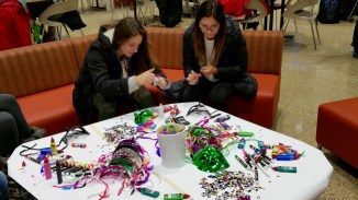 Students hard at work on their Mardi Gras masks.