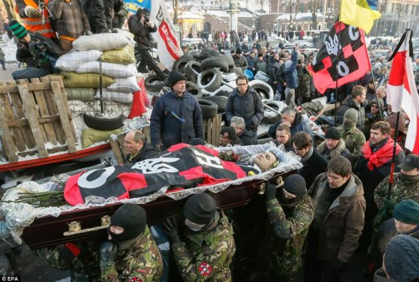 Photo:EPA  The body of Mikhail Zhiznevsky carried by opposition activists.