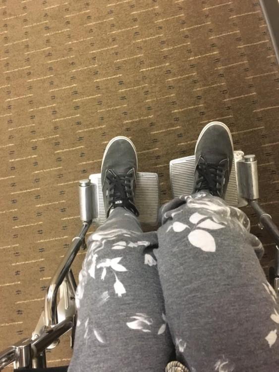 woman's legs wearing sweatpants in wheelchair