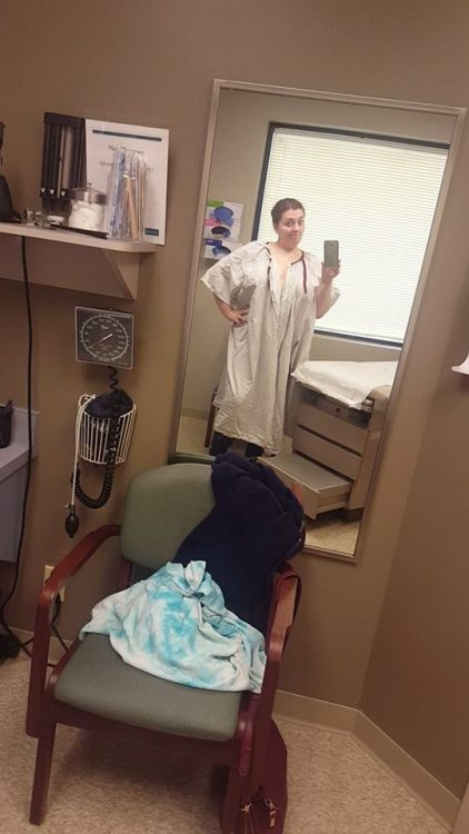 woman wearing a hospital gown in a doctor's office