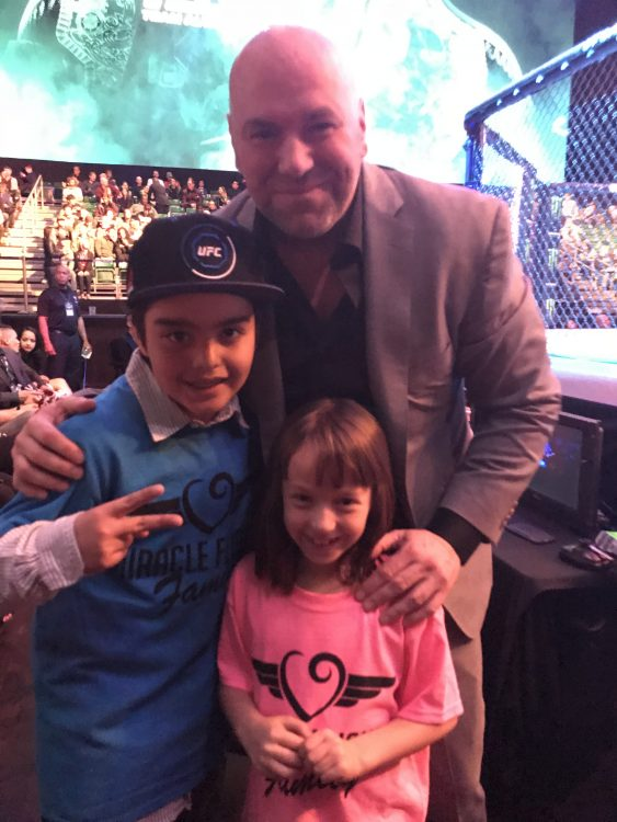 man standing with Miracle Fighters kids