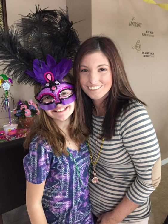the author with a girl wearing a purple mask