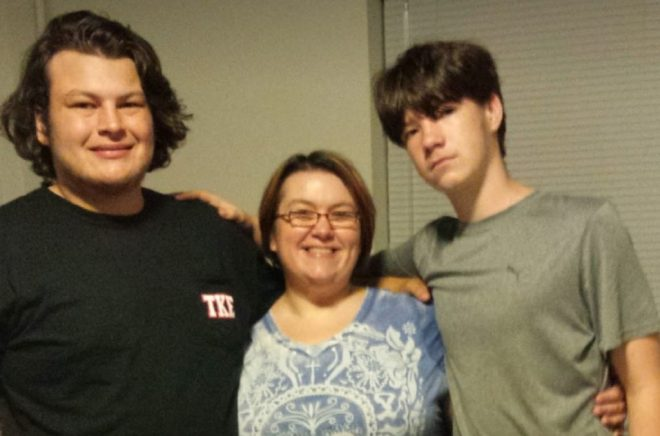 mother smiling with her two sons