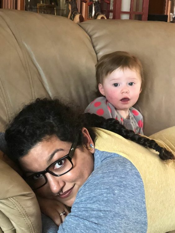 woman lying on couch with baby