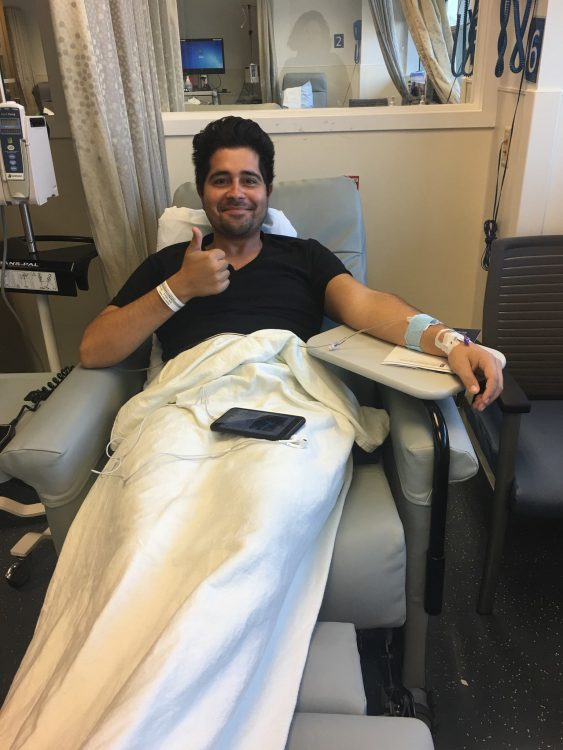 man in infusion chair giving thumbs up