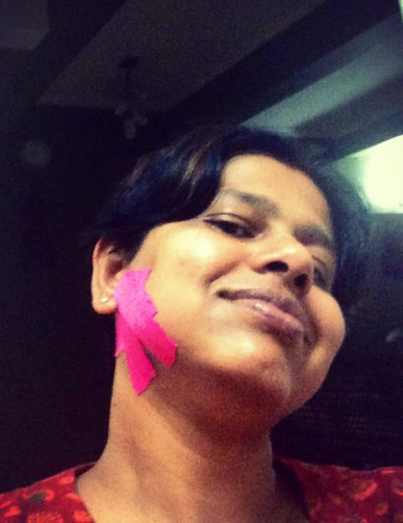 woman with pink kinesio tape on her jaw