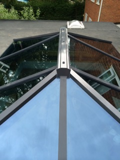 A contemporary roof lantern in anthracite grey aluminium