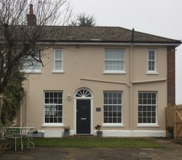 PVCu sliding sash windows in white woodgrain with a Solidor