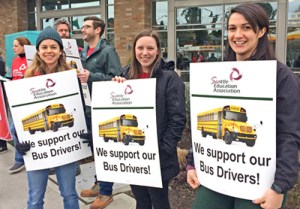 Seattle Education Association members picket Feb. 7 in support of Teamsters school bus drivers who struck First Student bosses. Nine-day strike led to gains in health care coverage, pensions.