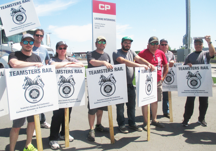 Striking rail workers at Canadian Pacific Intermodal Yard, Lachine, Montreal, May 30. Action by conductors and engineers shut down CP, delayed freight movement around North America.