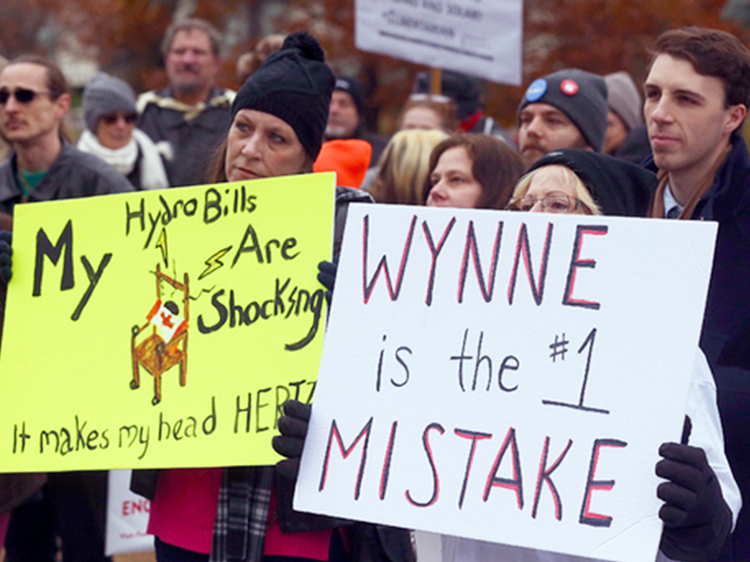 Protest in Toronto against rising cost of electric bills, Nov. 23, 2016, part of widespread working-class anger directed against Ontario Premier Kathleen Wynne. Her Liberal Party, governing for 15 years, lost to Progressive Conservative's Doug Ford, reflecting workers' frustrations.