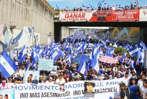 "Movement of Mothers of April lead march on Mother's Day, May 30, in Managua, Nicaragua, honoring those killed and wounded by government thugs during April demonstration. Banner reads ""No more assassinations! No more massacres!"" Nearly 300 people have been killed."