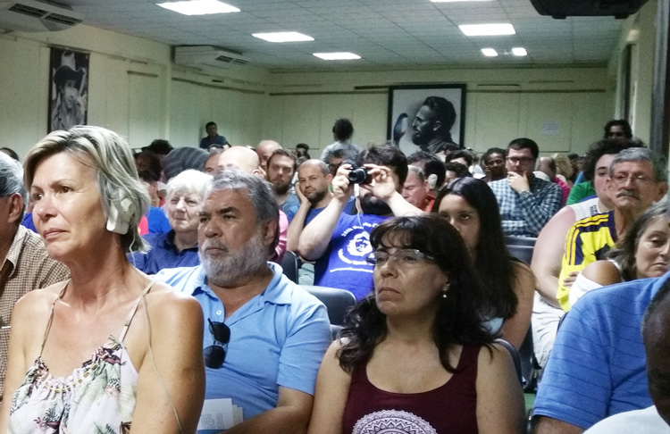 Above, participants in International May Day Brigade to Cuba hear from combatants in Cuba's revolutionary war. Inset, Teté Puebla, left, and Pérsida Chibás Ponce joined Rebel Army in their teens, were transformed in revolutionary struggle.