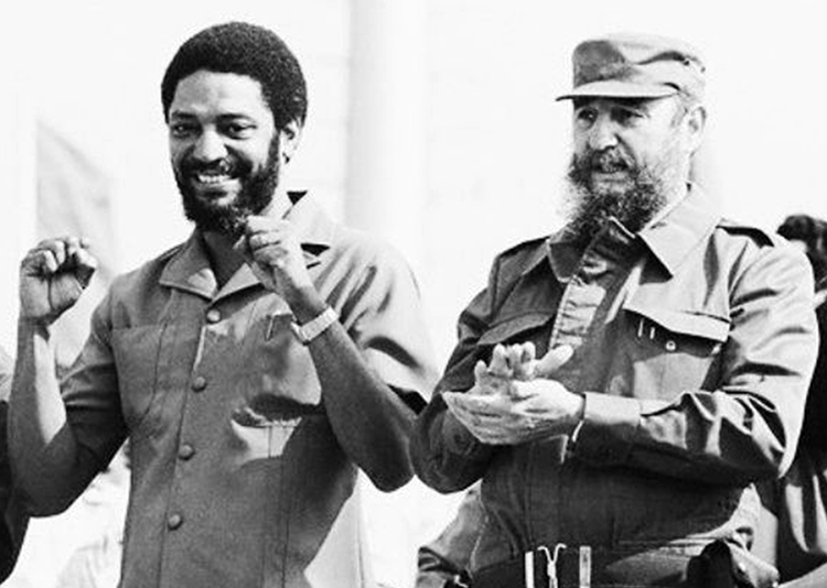 "Maurice Bishop, left, and Fidel Castro at May Day rally in Cuba, 1980. ""Grenada had become a true symbol of independence and progress in the Caribbean,"" Fidel Castro said after Bishop was killed in counterrevolutionary coup. ""No one could have foreseen the tragedy"" to come."