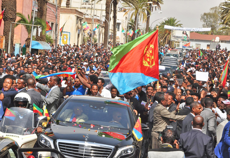"""Hundreds of thousands lined procession route from airport to center of Eritrea's capital Asmara when Ethiopia's Prime Minister Abiy Ahmed arrived July 8 to sign peace treaty after 20 years of war. Eritrean youth have been subjected to mandatory conscription for """"national service."""""""