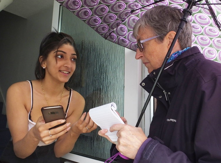 """Communist League member Catharina Tirsén, right, speaks with Vanessa Goral on her doorstep in Newbury Park in east London Sept. 22. In discussing fight against Jew-hatred, Goral said, """"I come from a Polish Roma family. Scapegoating of Roma people can be very strong."""""""