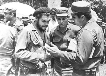 "From left, Ernesto Che Guevara, Alfonso Zayas, Rogelio Acevedo, at 1964 reunion of combatants in Rebel Army column led by Guevara. ""The Rebel Army was a political vanguard organization that was painstakingly selected and tested in battle,"" Mary-Alice Waters writes. ""As the revolutionary war advanced, these cadres became more educated and more politically homogeneous."""