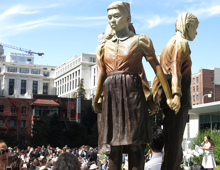 """Above, San Francisco statue of """"comfort women"""" who Japanese rulers kidnapped and forced into prostitution during second imperialist world war. Inset, 500 people attend Sept. 22 commemoration of statue's unveiling. Osaka, Japan, mayor ended its sister-city relationship with San Francisco in retaliation for memorial."""