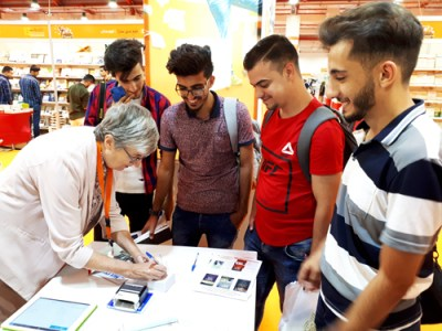 Munaf Ghanim, Mohammad Khalid Aswad, Safwan Al-Madany and Saad Salim, youth from Mosul fighting for rebirth of culture after defeat of Islamic State, visit Pathinder booth at Erbil International Book Fair.