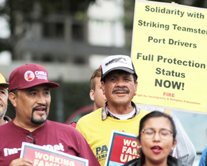 L.A. port strikers at immigrant rights action.