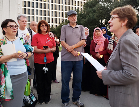 "Alyson Kennedy, SWP candidate for U.S. Senate from Texas, speaking at vigil in Dallas protesting anti-Semitic attack in Pittsburgh. ""Unions should speak out against Jew-hatred,"" she said."