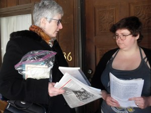 Amy Husk, left, Socialist Workers Party candidate for Kentucky governor, talks with Martha Blair on her doorstep in Whitesburg, Kentucky, Jan. 4, about party's campaign and upcoming May Day Brigade to Cuba. Blair said she was interested in working on both.