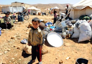 Syrian child in refugee camp, in Lebanon, 2014. Yearslong war grew out of Syrian dictatorship's brutal assault on popular rebellion, and interventions by Washington, Tehran, Moscow and other capitalist powers, leading to over 400,000 killed and millions driven from their homes.