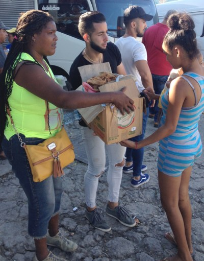 Volunteers provide solidarity, distributing clothing and shoes to residents of tornado-hit Regla neighbor-hood in Havana.