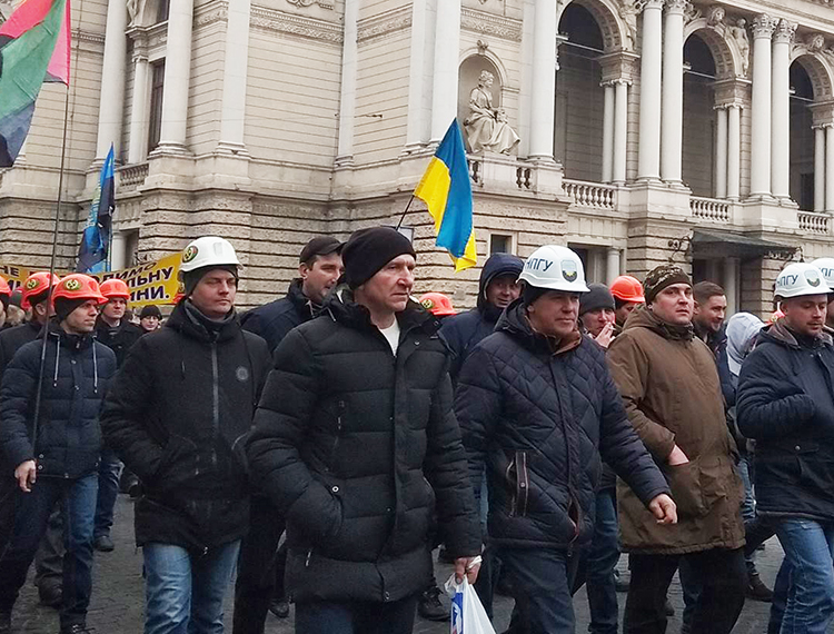Coal miners and supporters protest in Lviv, Ukraine, Feb. 6, demanding back pay. Some 4,000 of 12,000 miners in state-owned Lviv regional mines belong to independent miners union.