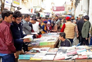 Al-Mutanabbi Street, Baghdad's historic booksellers' district, on a typical packed Friday Feb. 8. The stalls display books of every kind, political and not, in Arabic, English and other languages.