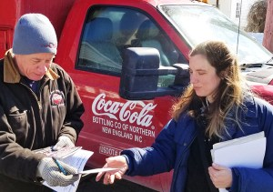 Truck driver Bill Scholl gets subscription to the Militant from Samantha Hamlin, Socialist Workers Party candidate for mayor of Troy, in his driveway in Waterford, New York, March 9.