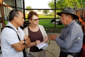 Alyson Kennedy, Socialist Workers Party candidate for mayor of Dallas, and campaign supporter Gerardo Sánchez, left, talk to construction worker Everardo Guerrero in Venus, Texas, May 8. He and his daughter got a subscription to the Militant, two books on special and made donation to Militant Fighting Fund.