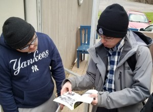 Socialist Workers Party campaigner Sergio Zambrana, right, talks with aerospace worker Kyle Miller at Miller's doorstep in Peru, New York, April 27, about party's program and activities.