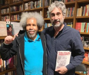 """Albert Woodfox, left, with Books and Books owner Mitchell Kaplan May 16. Almost 100 people jammed into Miami bookstore to hear Woodfox speak on his book Solitary: My Story of Transformation and Hope. Florida prison censors have tried to block the Militant from reaching inmates with his story, claiming it will """"lead to the use of physical violence."""""""
