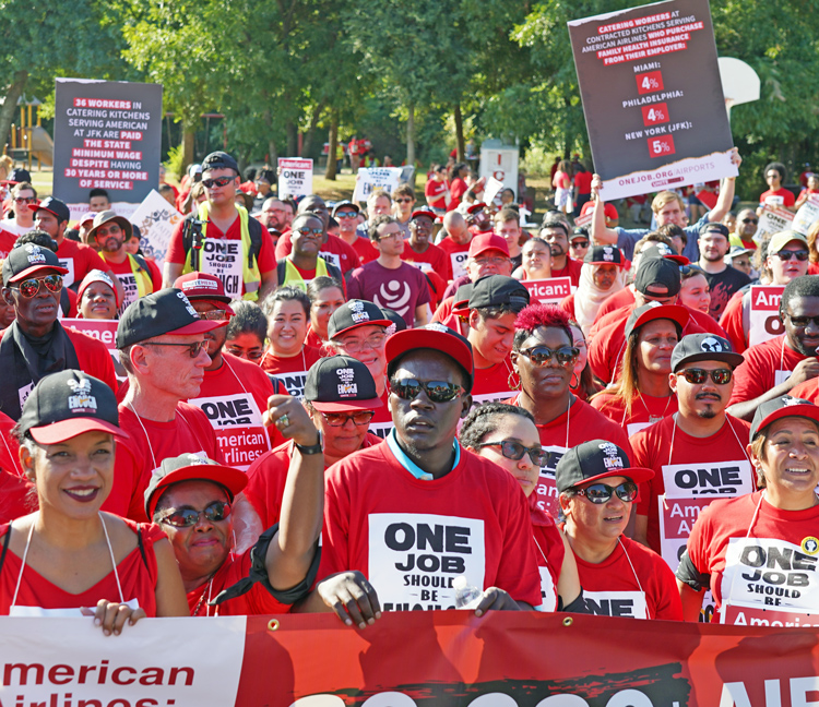 Hundreds of airline catering workers, working for LSG Skychefs, rally near American Airlines headquarters by Dallas-Fort Worth airport Aug. 13, demanding wage raises and new contract.