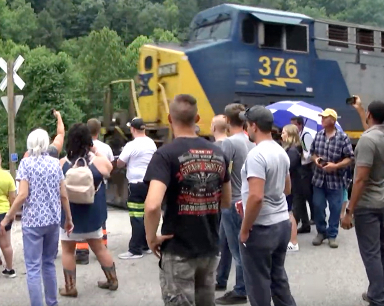 Laid-off Blackjewel miners and supporters express solidarity with rail workers as train engine leaves without coal cars. They've blocked tracks since July 29 in fight to be paid for work done.