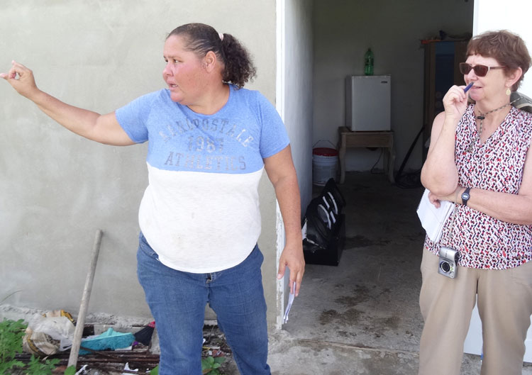 "Yasmin Morales, from family that live by fishing, describes conditions in El Negro area of Yabucoa in Puerto Rico to Alyson Kennedy, Socialist Workers Party 2016 presidential candidate Aug. 17. The capitalist parties are like ""sharks going after the small fish,"" Morales said."