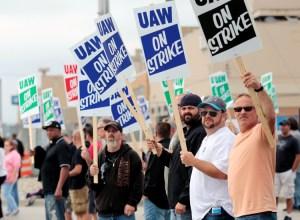 Autoworkers picket in Flint, Michigan, Sept. 16. Strike shut down 33 plants, 22 warehouses.