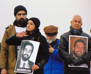 Nov. 17 protest at Lincoln Memorial demanding prosecution of cops who killed Bijan Ghaisar. At left is his sister, Negeen Ghaisar, with her husband. At right is his father, James Ghaisar.