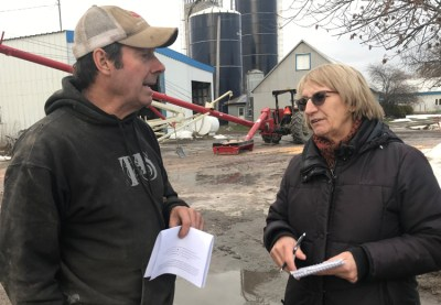 "Militant correspondent Sylvie Charbin talks with Pierre Robidoux on his farm outside Montreal Nov. 24 about CN rail workers strike. Robidoux said he appreciated discussion on need for alliance of farmers and workers, saying big business media ""doesn't care what we think."""