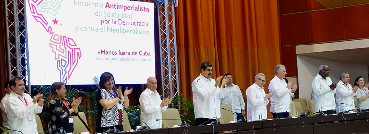 Conference close featured Venezuelan President Nicolás Maduro; Raúl Castro, first secretary Communist Party of Cuba; and Cuban President Miguel Díaz-Canel. From left, Fernando González, president Cuban Institute for Friendship with the Peoples; Teresa Amarelle, general secretary Federation of Cuban Women; Monica Valente, secretary general Sao Paulo Forum; José Ramón Machado Ventura, Communist Party of Cuba; Maduro; Castro; Díaz-Canel; Esteban Lazo, president Cuba's National Assembly; Ulises Guilarte, general secretary Central Organization of Cuban Workers; Socorro Gomes, president World Peace Council.