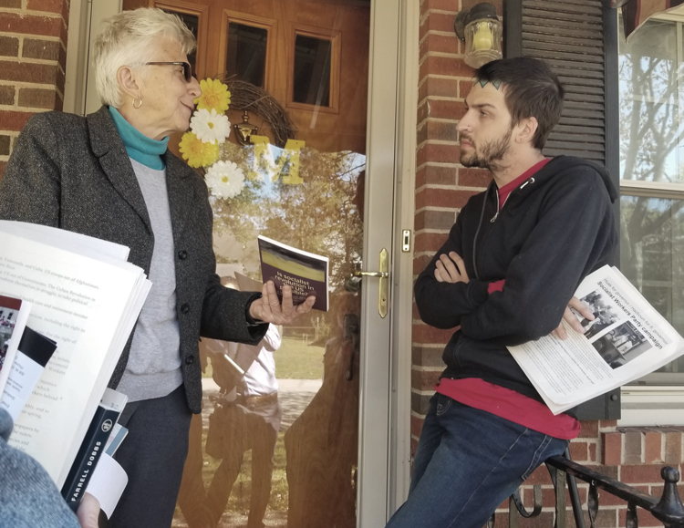 """SWP member Maggie Trowe talks with GM striker Kenneth Matczak at his doorstep in Bowling Green, Kentucky, Oct. 18. """"We're trying to raise the standard for all workers,"""" he said about their walkout. He got a Militant subscription and Is Socialist Revolution in the US Possible?"""