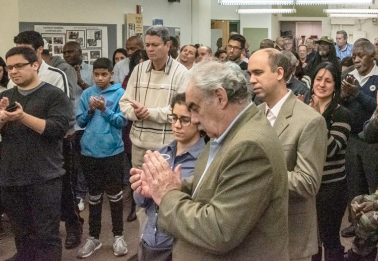 Humberto Rivero, Cuban ambassador to U.N., foreground, and SWP leader Steve Clark, inset, spoke at Jan. 5 New York reception celebrating accomplishments, example of Cuban Revolution.