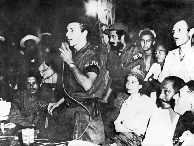 In address to congress of peasants near Rebel Army's Second Front headquarters in eastern Cuba, Sept. 21, 1958, Raúl Castro explains July 26 Movement's revolutionary program — taking land out of hands of big landholders and distributing to all those who work it.