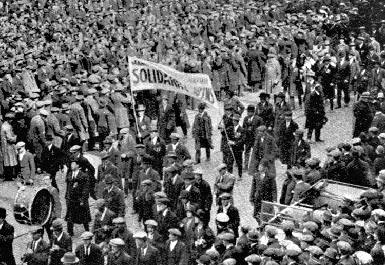 """Transit workers march in Manchester, England, during 1926 British general strike. Leon Trotsky explains the rise of """"unparalleled class battles"""" in the U.K. before and after first World War, as British imperialism declined in relation to its rivals in Berlin and especially Washington."""