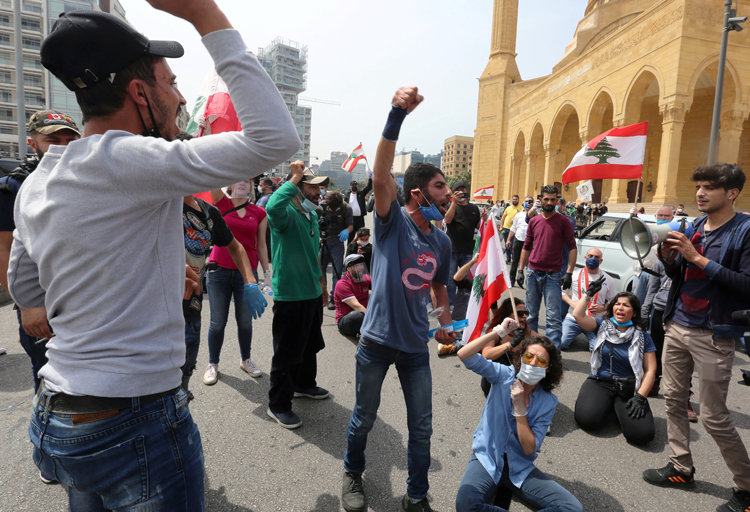 """""""We die from hunger or the disease,"""" Beirut protesters said April 21. """"Let us die taking a stand."""""""