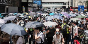 Demanding political rights, autonomy protesters block Pedder Street in Hong Kong May 27.