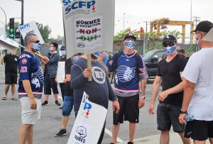 Port of Montreal Longshore picket July 27, during four-day strike against unsafe job schedules.