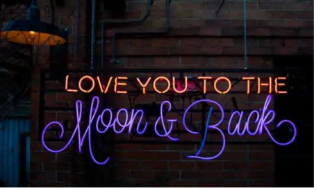 """Neon sign that reads """"love you to the moon and back."""""""