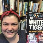 Charlotte holding White Tiger book